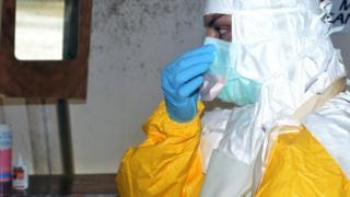 An MSF Ebola worker in Guinea - July 2014