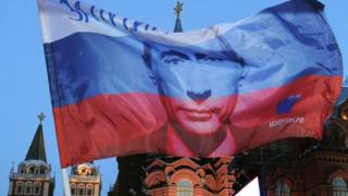 Russian flag with President Putin's face