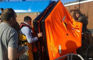 Life-raft being brought ashore at Hartlepool Fish Quay