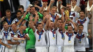 Germany's team holding the World Cup
