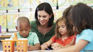 Early years teacher with children