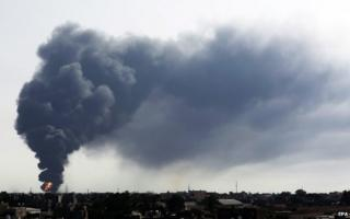 Smoke billows from a fuel storage depot near the airport in Tripoli, Libya, 28 July