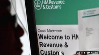 A man views a tax return form