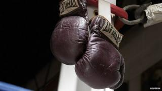 The 1971 Muhammad Ali gloves from his first Joe Frazier bout are pictured in this undated handout photo courtesy of Heritage Auctions received July 31, 2014
