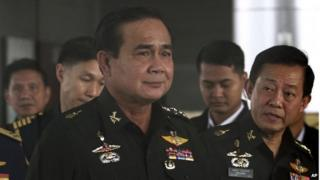 In this 13 June 2014 file photo, Thailand's Army commander General Prayuth Chan-ocha, left, arrives at the Royal Thai Army Club in Bangkok, Thailand.