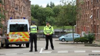 Police in Clune Park Street