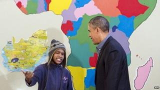 A young South African raps for US President Barack Obama during a tour of the Desmond Tutu HIV Foundation Youth Centre in Cape Town, South Africa - 30 June 2013
