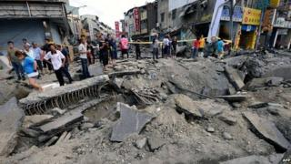 Local residents look at the damage caused by gas explosions in the southern Taiwan city of Kaohsiung on 1 August 2014