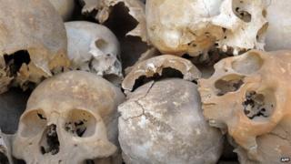 Human skulls are displayed at the Choeung Ek killing fields memorial in Phnom Penh on 16 September, 2010
