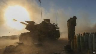 Israeli tanks fire shells toward targets in the Gaza Strip - 2 August 2014