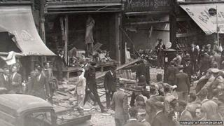 The scene after the explosion with crowds gathering