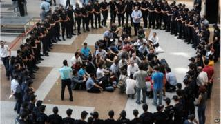 Anti-terror and riot police surround former colleagues detained on suspicion of spying or of illegally wiretapping government officials, including prime minister Recep Tayyip Erdogan and Turkey's spy chief, inside a courthouse in Istanbul, Turkey Saturday, July 26, 2014
