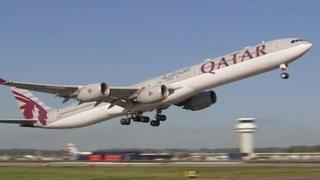 Library image of Qatar Airways plane