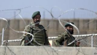 Afghanistan National Army soldiers stand guard at a gate of Camp Qargha, west of Kabul, Afghanistan 5 August 2014