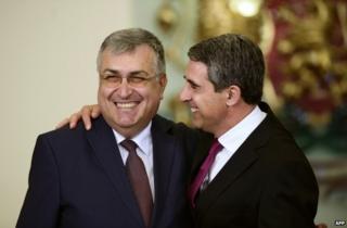 Bulgarian President Rosen Plevneliev (right) hugs new caretaker Prime Minister Georgi Bliznashki in Sofia, 5 August