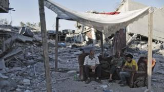 Palestinians in the Shejaia neighbourhood