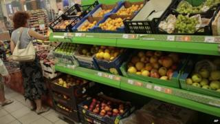 People buy imported fruit at a supermarket in downtown Moscow