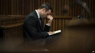 Oscar Pistorius reacts as he listens to the state prosecutor closing argument at his murder trial in Pretoria, South Africa - 7 August 2014