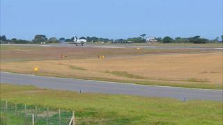Plane landing at Guernsey Airport