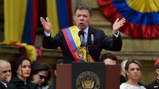 Colombian President Juan Manuel Santos delivers a speech during the inauguration ceremony at the National Congress on 7 August 2014 in Bogota, Colombia