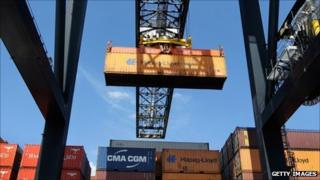 Cargo containers being moved at a port
