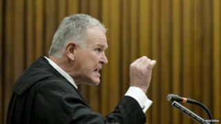 Defence lawyer Barry Roux makes a point during closing arguments in the murder trial of South African Olympic and Paralympic sprinter Oscar Pistorius in the North Gauteng High Court in Pretoria August 8