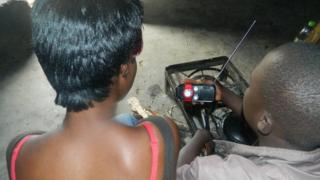 People listening to a radio in Zimbabwe