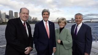 Australian Foreign Minister Julie Bishop (2nd R) with US Secretary of State John Kerry (2nd L), US Secretary of Defence Chuck Hagel (R) and Australian Defence Minister David Johnston (R) in Sydney on 12 August 2014