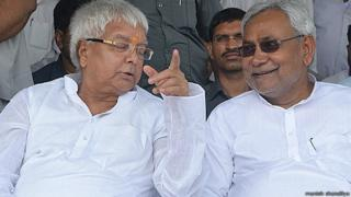 Lalu Prasad Yadav (left) says his alliance with Nitish Kumar (right) will defeat the BJP