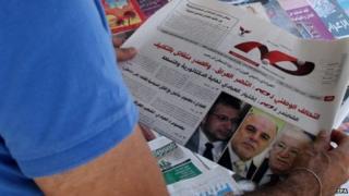 Man reads Iraqi newspaper Khabar
