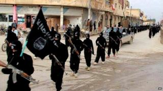 Islamic State fighters marching in Raqqa, in northeastern Syria - 14 January 2014