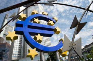 Barbed wire hung over the ECB logo in Frankfurt as part of an installation (7 August 2014)