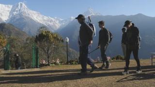 Trekkers looking at peaks