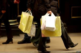 People carrying shopping bags in Oxford Street