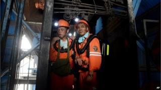 Rescuers prepare to go into the Dongfang Coal Mine in Huainan city of China's eastern Anhui Province on 19 August, 2014