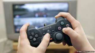 Boy playing on PlayStation