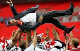 Swansea City celebrate winning promotion in 2011