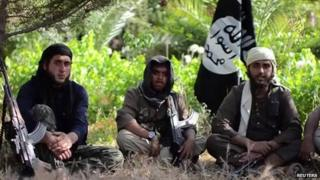 Three young men in an extremist recruitment video