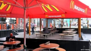 Tables outside Moscow McDonalds, mostly standing empty