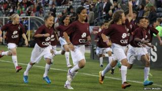 Young Colorado Rapids supporters take the field as the Rapids face the the Montreal Impact at Dick's Sporting Goods Park in Commerce City, Colorado 24 May 2014