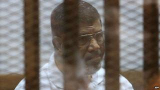 Mohammed Morsi in court on 18 August 2014