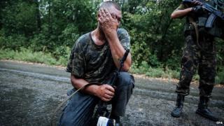 Ukrainian soldier close to checkpoint near town of Gorlovka. 28 Aug 2014