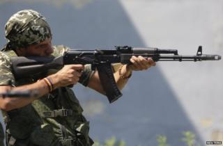 Spanish volunteer Rafa Munoz Perez practising with a rifle in Donetsk, 7 August