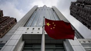 """The Chinese national flag flies in front of the Liaison Office of the Central People""""s Government in Hong Kong on August 27"""