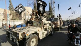 Militant Islamist fighters from IS take part in a parade in Raqqa Syria 30 June 2014
