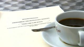 Cup of coffee and a food hygiene document