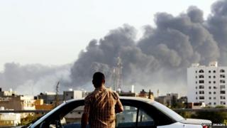 Smoke billows over Tripoli amid fighting for control of the capital