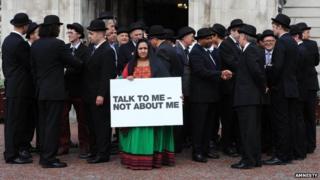 Samira Hamidi protesting outside Cardiff City hall