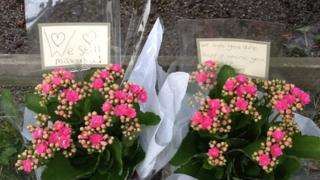 Flowers outside the home of the al-Hilli family in Claygate, Surrey