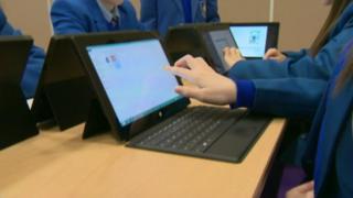 Schoolgirls using tablet computers
